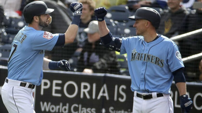 Seattle Mariners' Mitch Haniger, left, celebrates with Kyle Seager after hitting a two-run home run