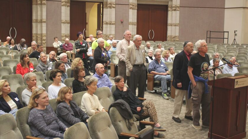 Ron Rabens asks Congress member Scott Peters a question during the April 19 town hall meeting at Con
