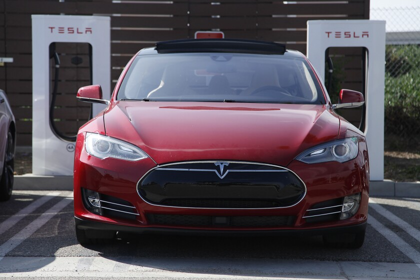 The new Tesla Model S P85D produces extra power with the addition of a second electric motor putting out the equivalent of 691 horsepower.