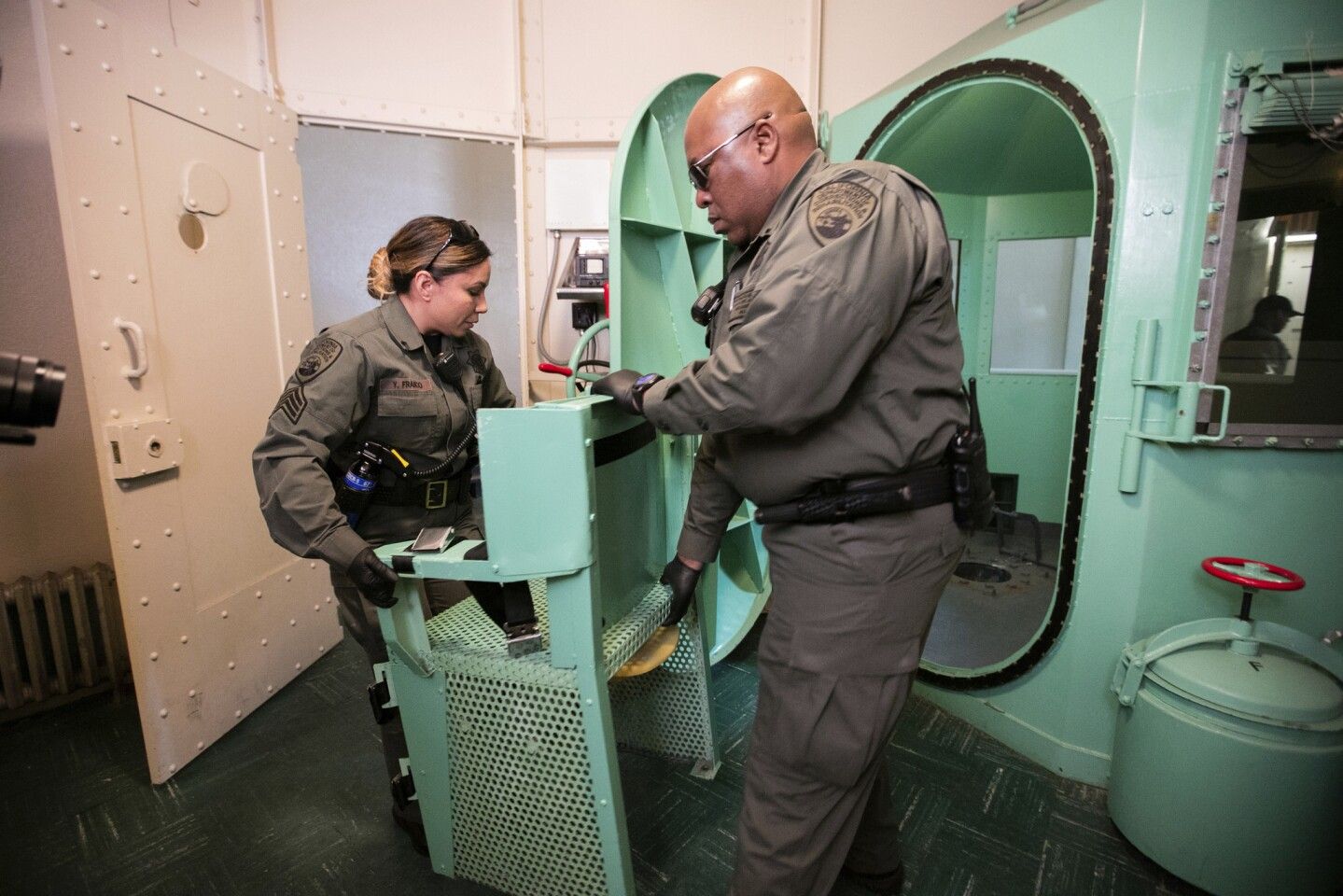 A chair is removed from the death penalty chamber at San Quentin State Prison.