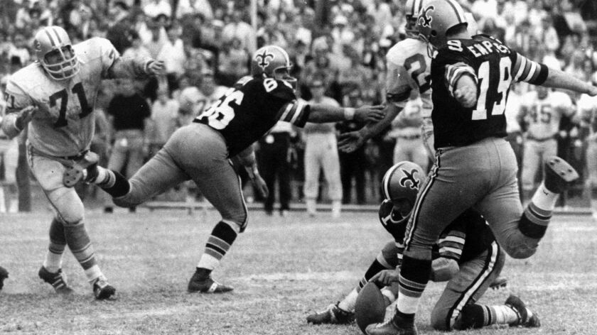 San Dieguito alum Tom Dempsey kicks an NFL-record 63-yard field goal for the Saints in 1970.