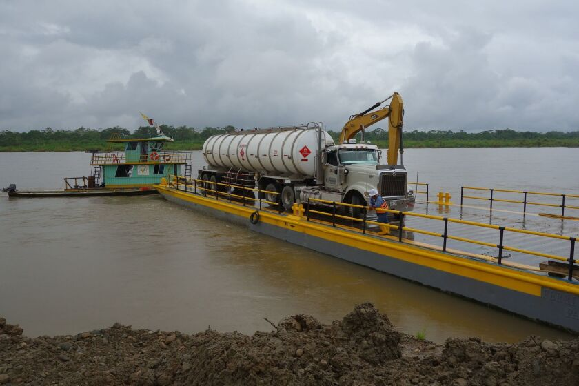 A tanker truck is shown being ferried across the Putumayo River in southern Colombia on Saturday. FARC guerrillas last week forced drivers of 22 of the vehicles to dump their loads on highways around Puerto Asis.