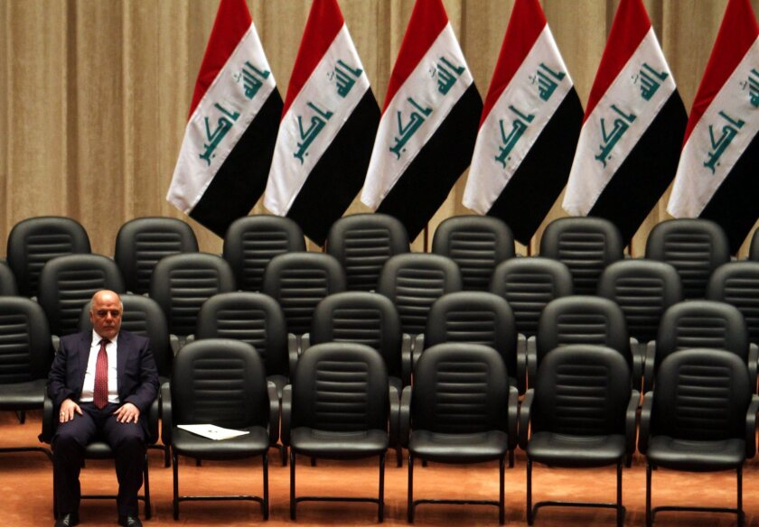 New Iraqi Prime Minister Haider Abadi waits for members of his Cabinet to arrive during a parliament session in Baghdad.