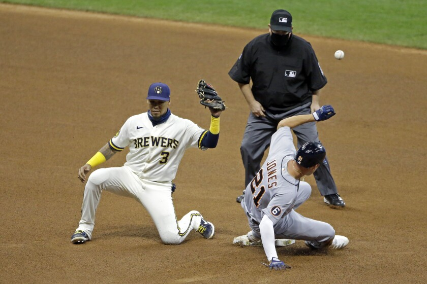 Milwaukee Brewers' Orlando Arcia (3) is unable to control a throw as Detroit Tigers' JaCoby Jones (21) steals second base during the fourth inning of a baseball game Tuesday, Sept. 1, 2020, in Milwaukee. Jones advanced to third base on the play. (AP Photo/Aaron Gash)