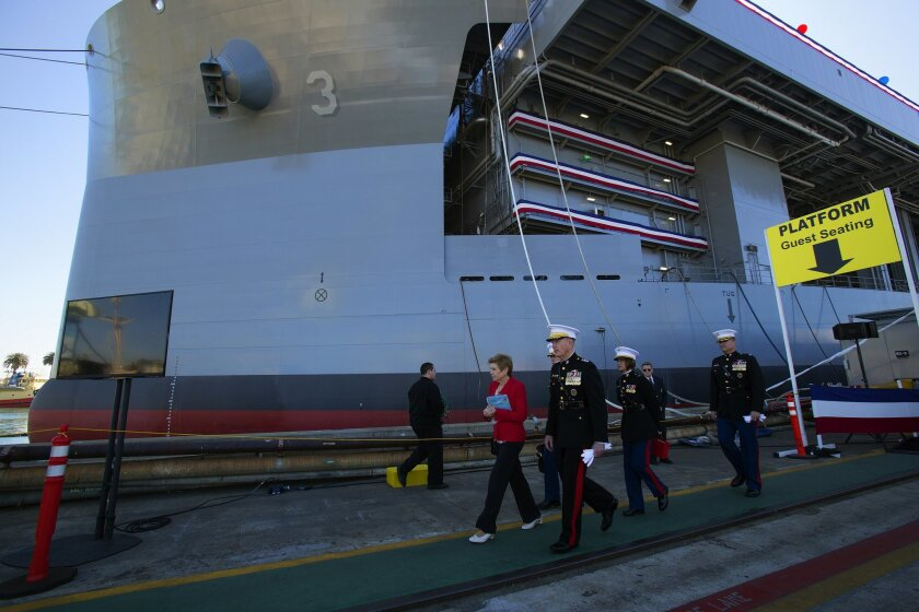 Gen. Joseph F. Dunford, Jr., Marine commandant, departs from the christening ceremony held at the NASSCO shipyard for the Navy's newest ship the USNS Lewis B. Puller (MLP 3 AFSB) named in honor of a Marine legend.