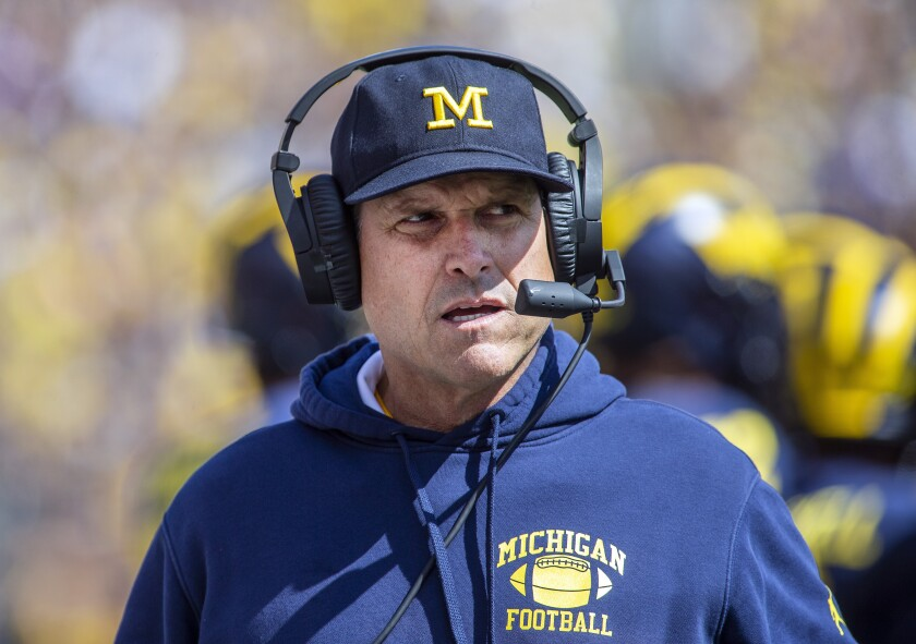 FILE - This Sept. 7, 2019, file photo, Michigan head coach Jim Harbaugh watches from the sideline in the first half of an NCAA college football game against Army, in Ann Arbor, Mich. Harbaugh, who has two years left on his deal, says he was close to a contract extension before coping with the pandemic became a priority. (AP Photo/Tony Ding, File)