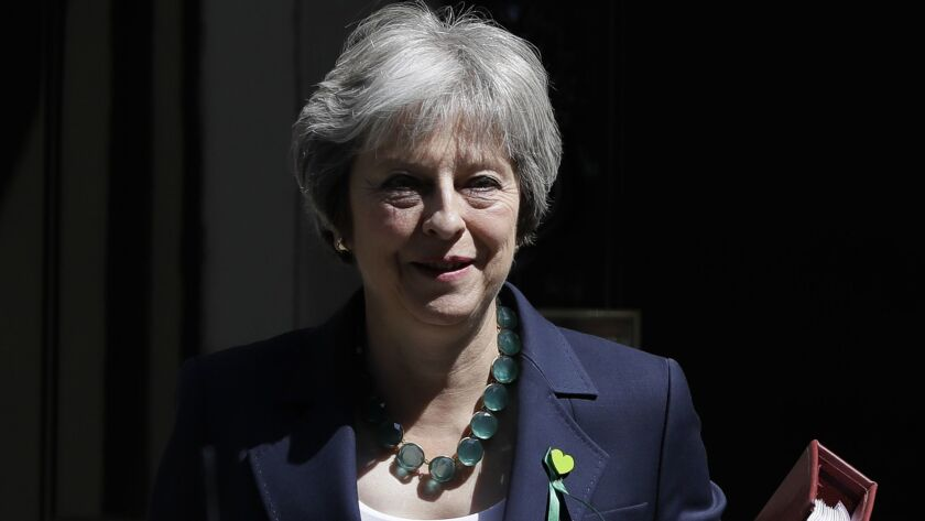Britain's Prime Minister Theresa May leaves 10 Downing Street to attend the weekly session of PMQs a