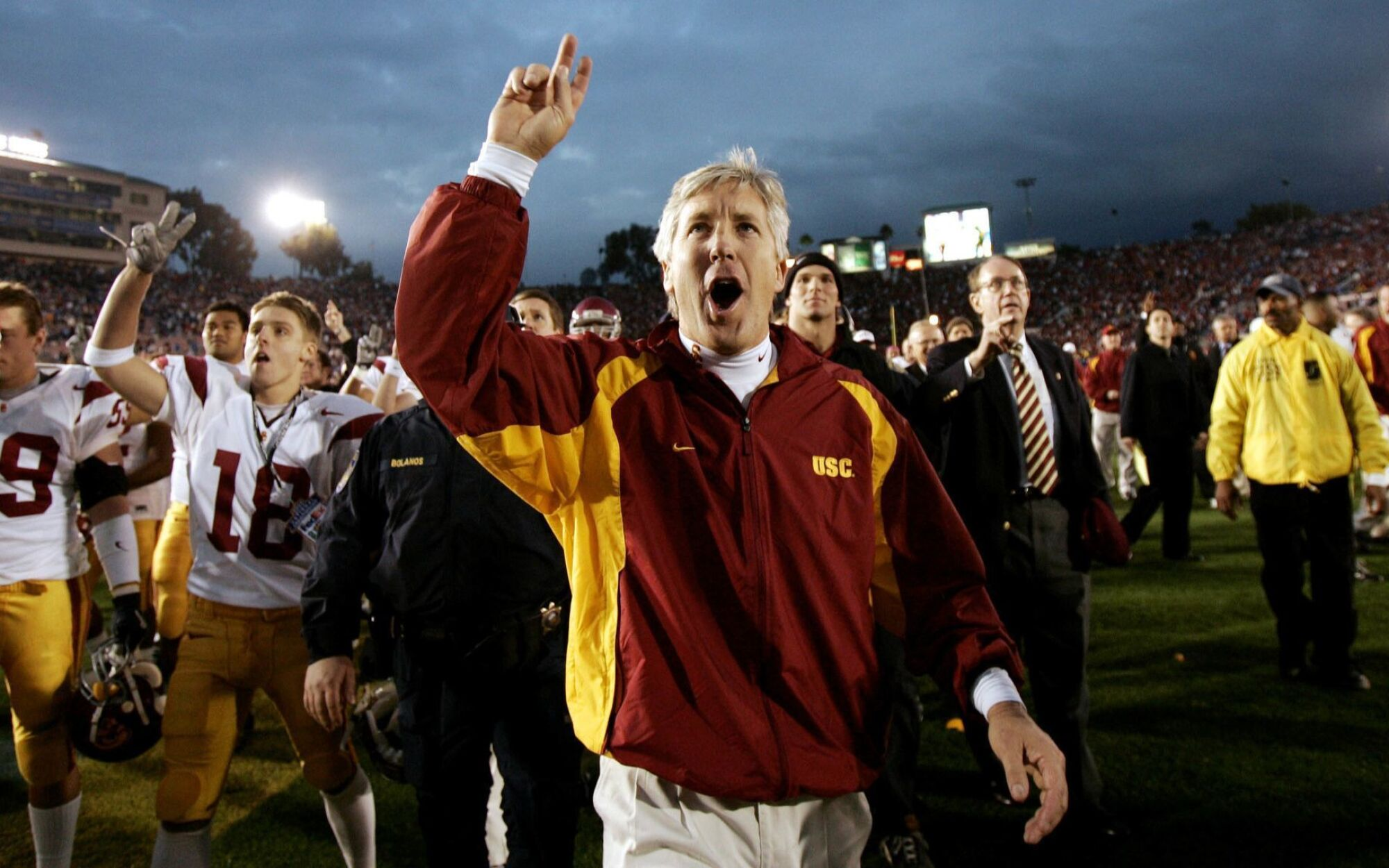 USC coach Pete Carroll celebrates with members of his team after defeating UCLA at the Rose Bowl in 2004.