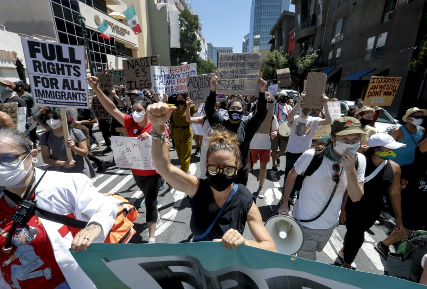 Protesters march during a Freedom For All demonstration on Saturday