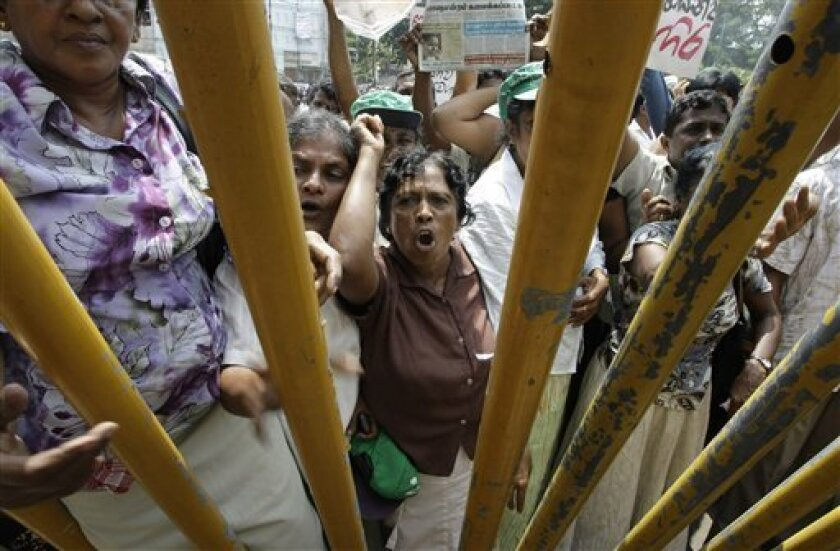 Protesters supporting defeated presidential candidate Gen. Sarath Fonseka shout slogans against the government during a protest in Colombo, Sri Lanka, Wednesday, Feb. 10, 2010. Government supporters hurled stones at opposition activists protesting the arrest of their defeated presidential candidate in Sri Lanka's capital Wednesday, in scattered street battles that prompted volleys of tear gas from police. (AP Photo/Eranga Jayawardena)
