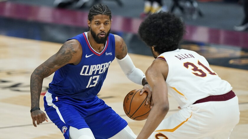 Clippers' Paul George drives to the basket against Cleveland Cavaliers' Jarrett Allen.