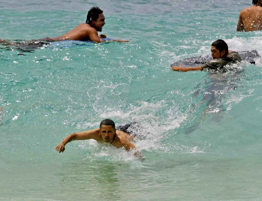 FILE - In this Aug. 14, 2008 file photo, Democratic presidential candidate Barack Obama body surfs at Sandy Beach while on vacation in Honolulu, Hawaii. Two Honolulu city councilmen have dropped plans to rename Sandy Beach Park, a popular beach for President Barack Obama Sandy Beach Park. The Honolulu Star-Advertiser reports Councilman Stanley Chang and Council Chairman Ernie Martin decided to withdraw the proposal after hearing from the public. The beach is a popular bodysurfing spot not on Oahu's east side. (AP Photo/Alex Brandon, File)