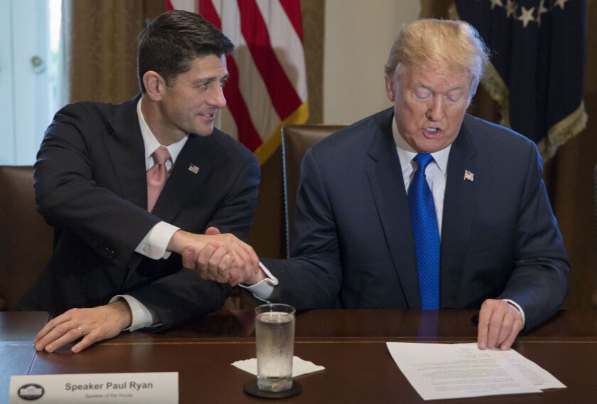 President Trump and House Speaker Paul D. Ryan (R-Wis.) shake hands on the GOP tax plan Thursday at the White House.