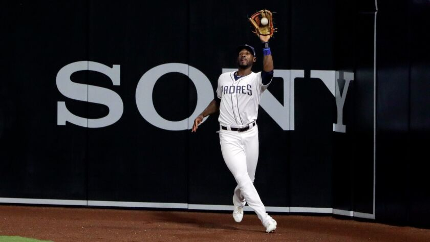San Diego Padres right fielder Jabari Blash makes the catch at the wall for the out on St. Louis Car