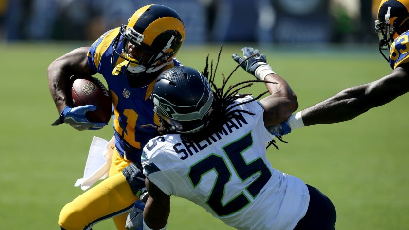Rams wide receiver Tavon Austin tries to get around Seahawks cornerback Richard Sherman in the second quarter.