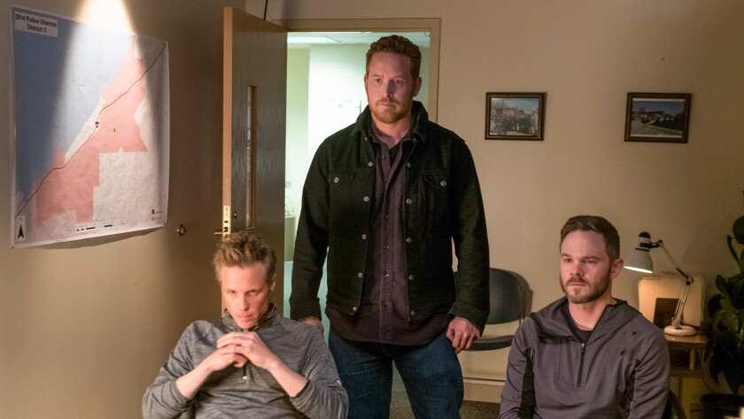 """Ashton Holmes, left, Cole Hauser and Shawn Ashmore in the movie """"Acts of Violence."""""""