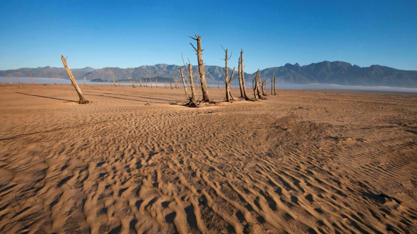 The Theewaterskloof Dam, one of Cape Town's six main dams, dwindled to 10% capacity remaining after three years of punishing drought.