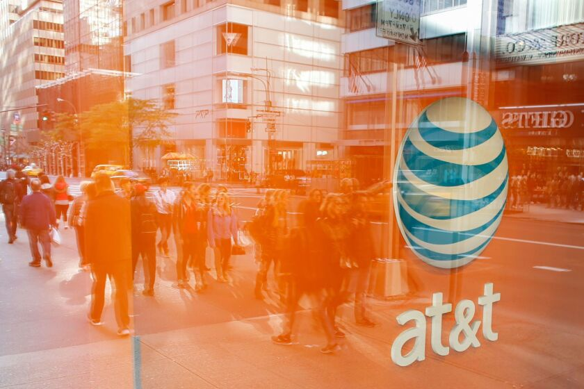 Opponents of AT&T's deal to buy Time Warner said the collusion suit was another reason for regulators to reject the deal. Above, an AT&T store in New York City.