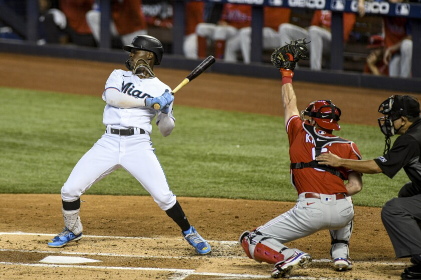 Miami Marlins' Jazz Chisholm Jr. avoids a wild pitch during the first inning of a baseball game against the Philadelphia Phillies, Sunday, Oct. 3, 2021, in Miami. (AP Photo/Gaston De Cardenas)