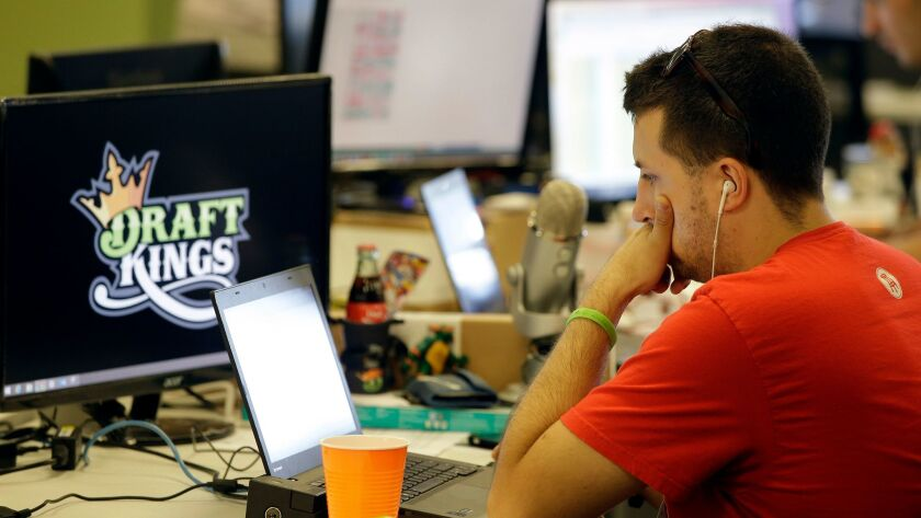 Devlin D'Zmura, a trending news manager at DraftKings, works on his laptop at the company's offices in Boston in 2015.