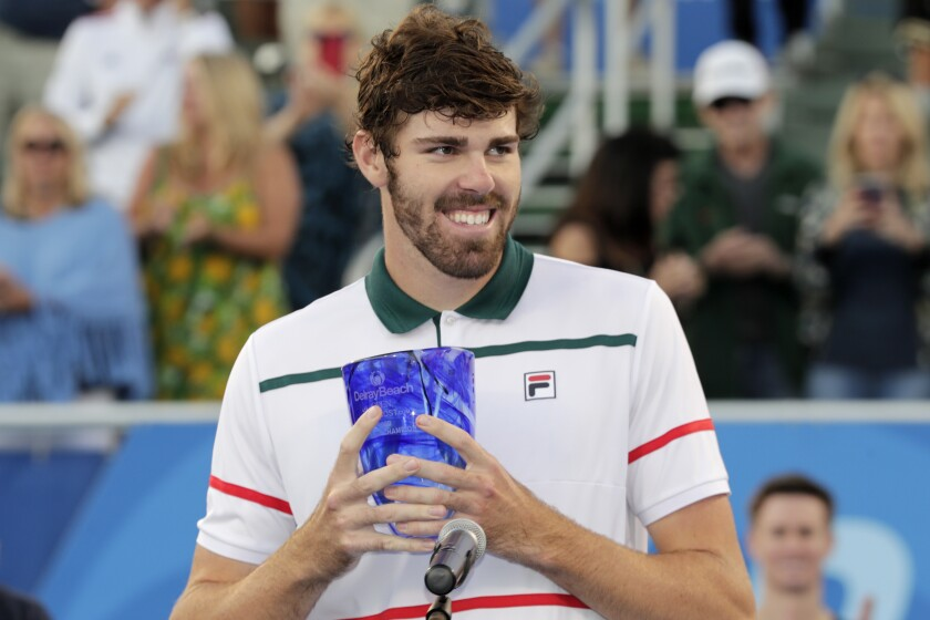 Reilly Opelka holds the trophy after winning the Delray Beach (Fla.) Open title match Feb. 23, 2020.