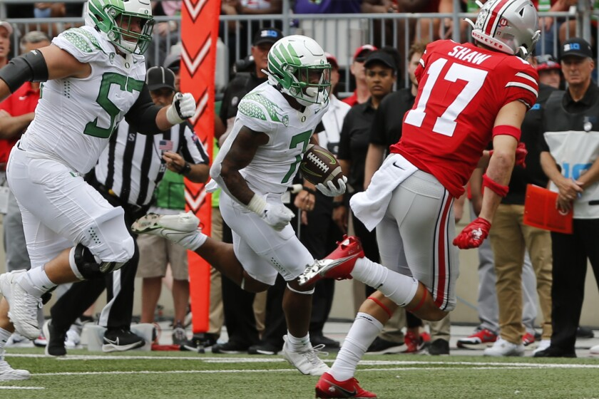 Oregon running back CJ Verdell, middle, scores a first-half touchdown against Ohio State on Saturday.