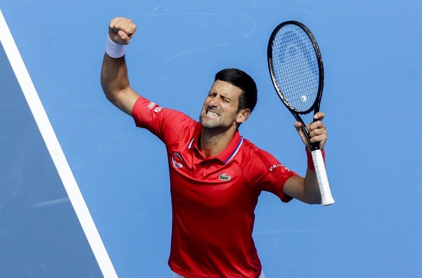 Serbia's Novak Djokovic celebrates after defeating Canada's Denis Shapovalov in their ATP Cup match in Melbourne, Australia, Tuesday, Feb. 2, 2021. (AP Photo/Hamish Blair)