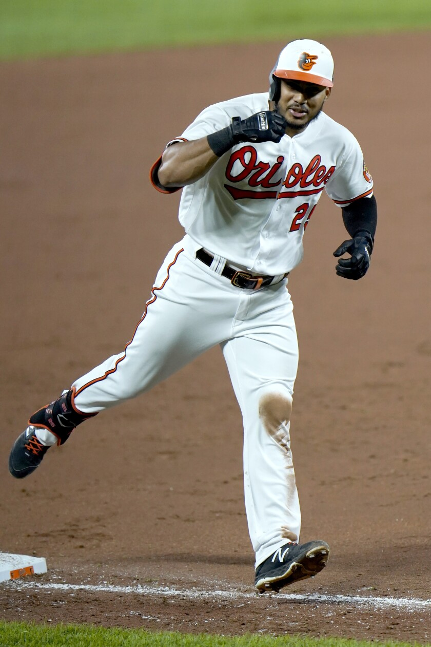 Baltimore Orioles' Anthony Santander reacts while running the bases after hitting a two-run home run off New York Mets relief pitcher Franklyn Kilome during the sixth inning of a baseball game, Tuesday, Sept. 1, 2020, in Baltimore. Orioles' Pat Valaika scored on the home run. (AP Photo/Julio Cortez)