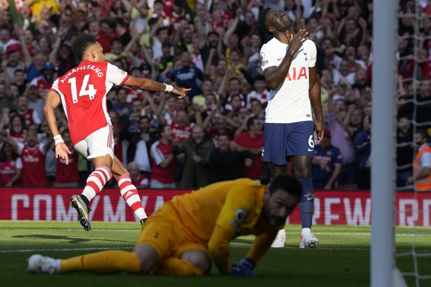 Arsenal's Pierre-Emerick Aubameyang, left, celebrates after scoring his side's second goal during the English Premier League soccer match between Arsenal and Tottenham Hotspur at the Emirates stadium in London, Sunday, Sept. 26, 2021. (AP Photo/Frank Augstein)