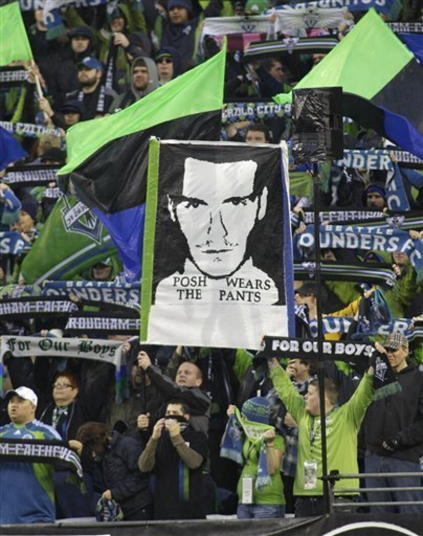"Seattle Sounders supporters hold a sign that reads ""Posh wears the pants"" in reference to Victoria ""Posh Spice"" Beckham, the wife of Los Angeles Galaxy's David Beckham, prior to a MLS soccer match, Tuesday, March 15, 2011, in Seattle. (AP Photo)"