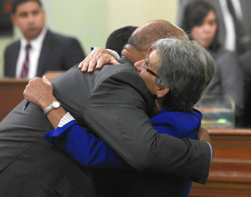 State Sen. Hannah-Beth Jackson hugs Assemblyman Chris Holden after the Assembly approved her measure tightening rules for terminating franchise agreements.