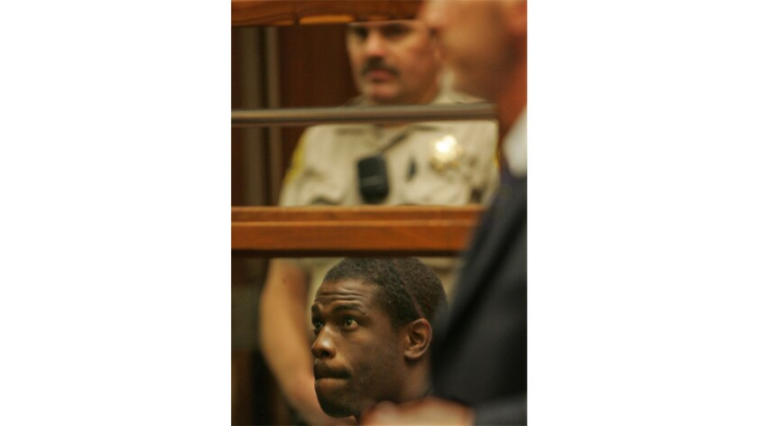 Former NFL running back Lawrence Phillips in court in Los Angeles in 2005. Phillips died Wednesday after a suspected suicide attempt in his prison cell in Kern County.