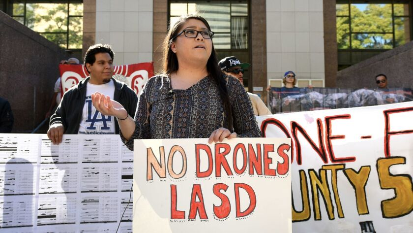Vanessa Deleon speaks against the use of drones by the Los Angeles County Sheriff's Department during a news conference outside the Los Angeles County Hall of Administration.