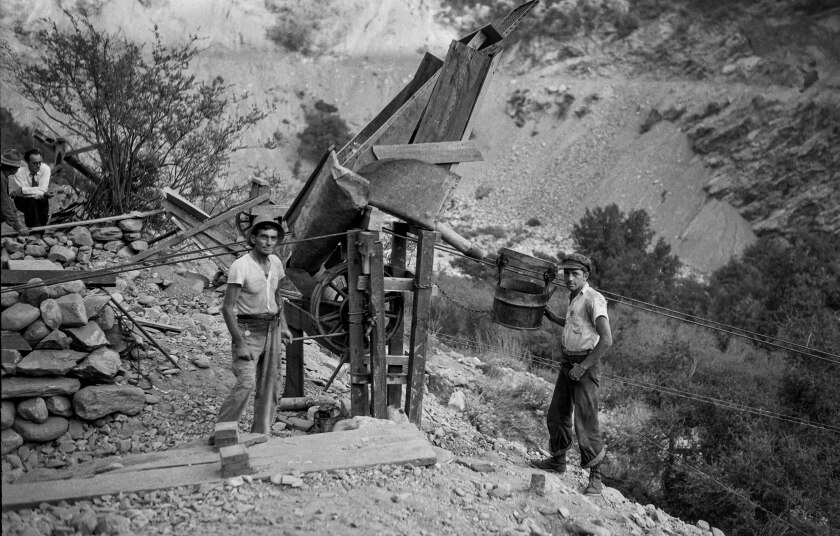 September 1932: M.L. Sims and Archie Clark send loads of gold-laden dirt down from their diggings to the East Fork of the San Gabriel River for washing.