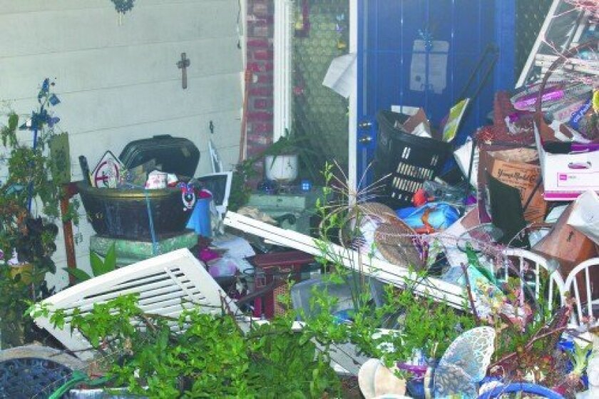 The family of Robert Stella spent three weeks removing trash and items hoarded at his home by his estranged wife. File