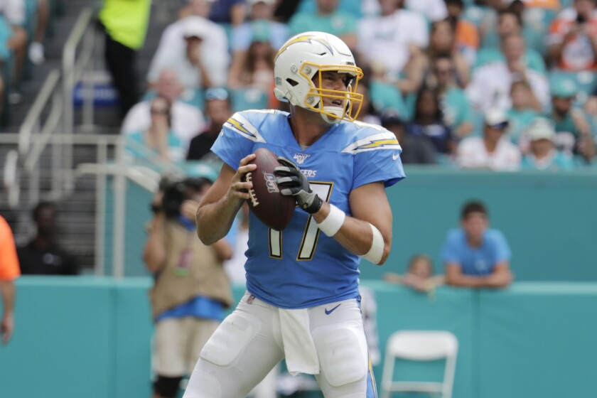 Chargers quarterback Philip Rivers looks to pass against the Dolphins.