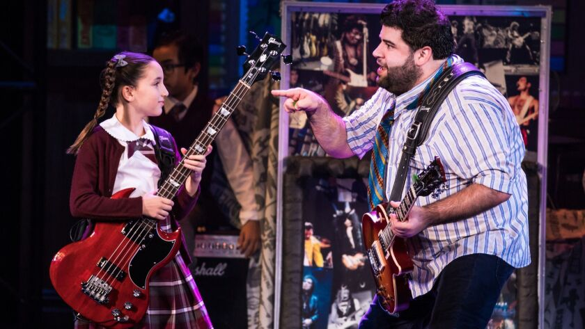 la-et-cm-school-of-rock-pantages -- Theodora Silverman, left, and Rob Colletti in the School of Roc