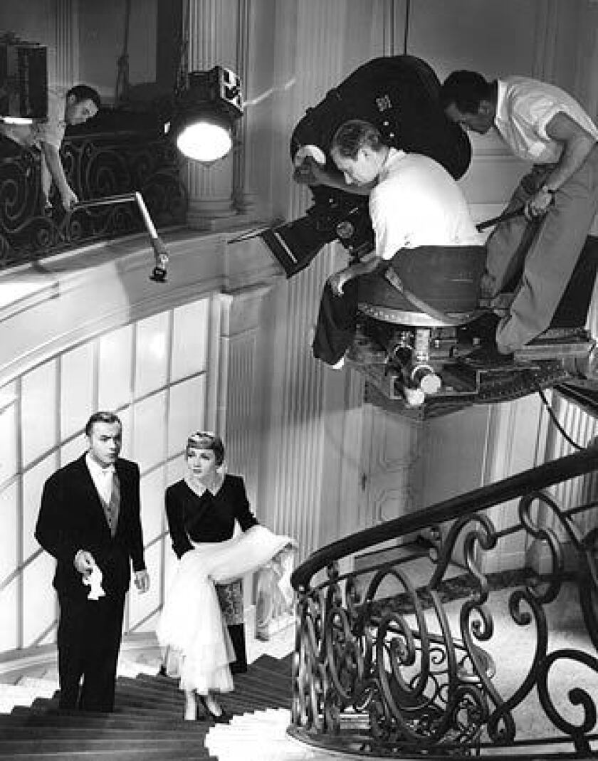 """Charles Boyer and Claudette Colbert, early actors who gained celebrity status, play a royal Russian couple who take domestic jobs in 1937's """"Tonight's Our Night."""""""
