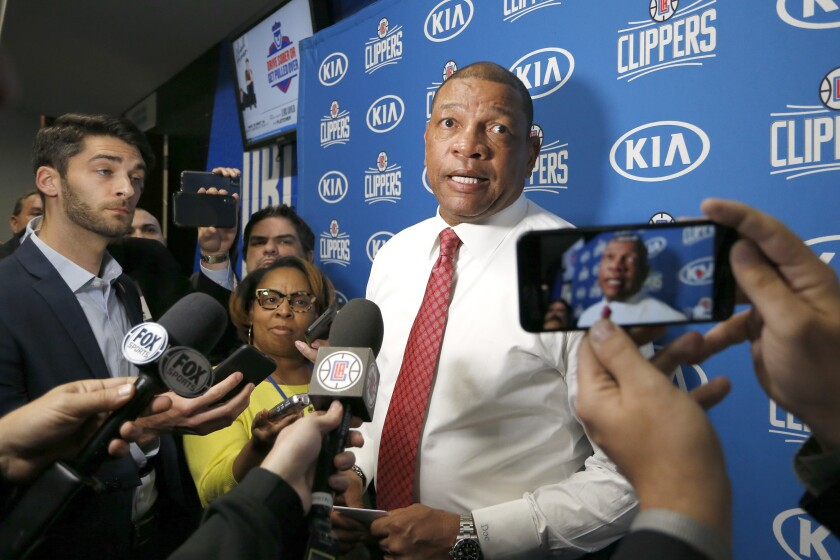 Clippers coach Doc Rivers talks with the media after a game against Orlando earlier this season.