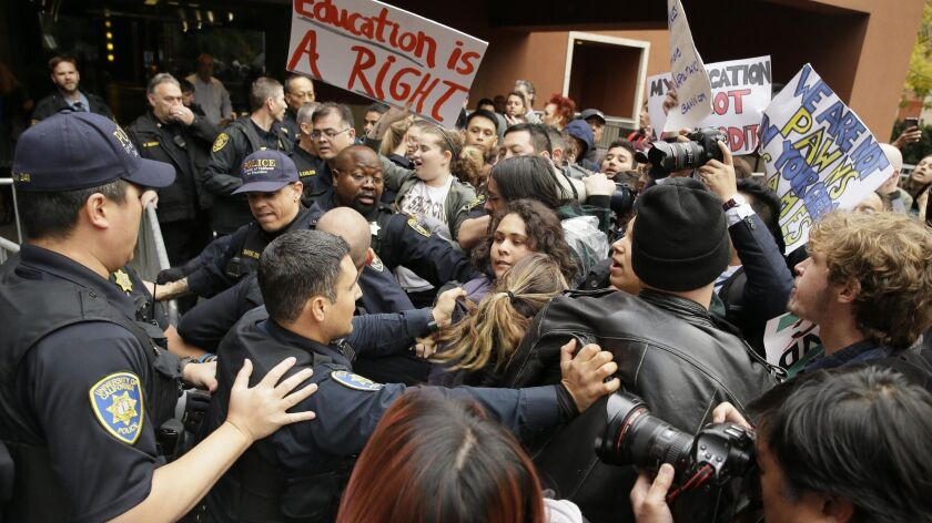 University of California police confront protesters