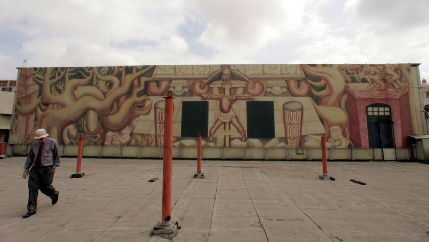 A rendering of David Alfaro Siqueiros' mural covers the actual mural in 2006, as the city prepared to do needed conservation work to bring it back to life.