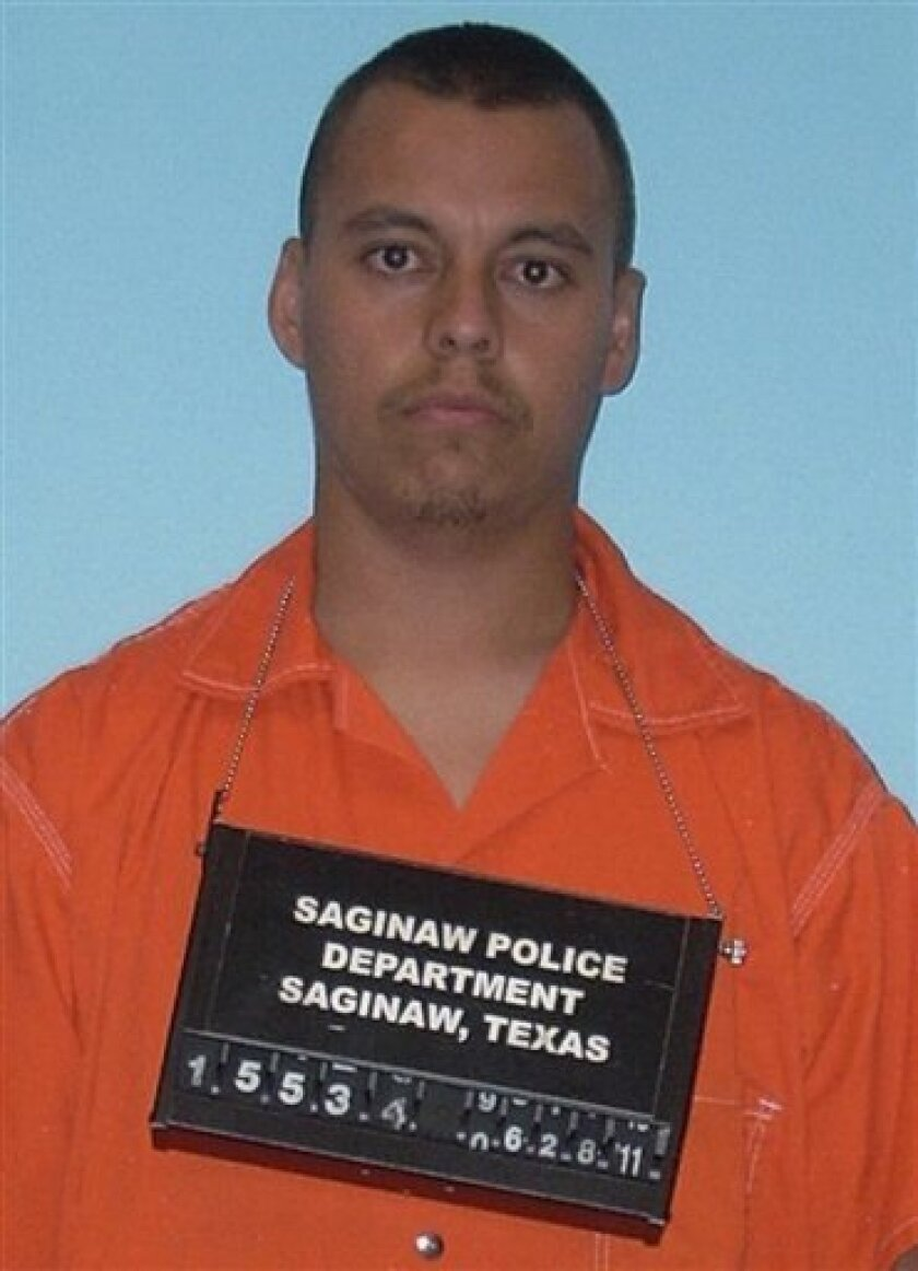This booking photo provided by the Saginaw Police Department shows 22-year-old Carlos Rico. Police say Rico abandoned his 4-year-old son along a West Texas highway, and the injured boy spent several hours alone in the dark before a passing motorist picked him up. (AP Photo/Saginaw Police Dept.)