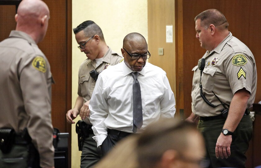 Lonnie Franklin Jr. enters the courtroom early in his murder trial. Franklin is charged with the so-called Grim Sleeper killings that terrorized South L.A. over more than two decades.