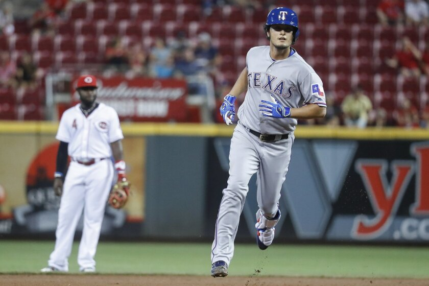 Texas Rangers' Yu Darvish runs the bases after hitting a solo home run off Cincinnati Reds starting pitcher Tim Adleman during the fifth inning of a baseball game, Wednesday, Aug. 24, 2016, in Cincinnati. (AP Photo/John Minchillo)