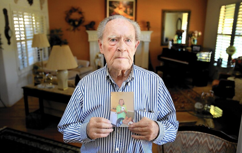 Denny Ragan, 86, holds a picture of his wife Barbara, who committed suicide by jumping off a parking structure at the Kaiser Permanente Santa Rosa Medical Center.