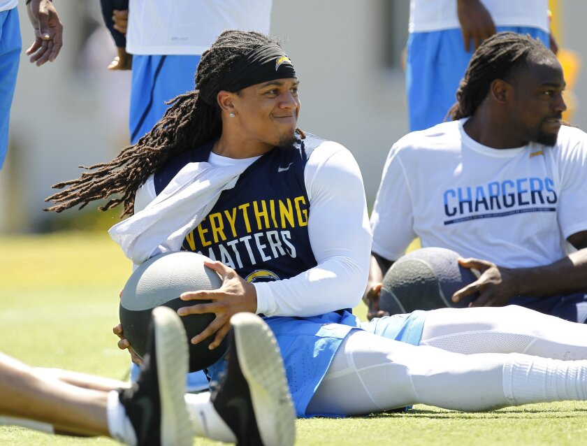 Chargers Jason Verrett works out with a medicine ball during the team's first offseason workout.