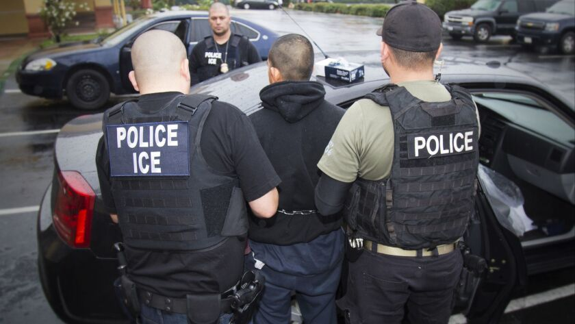 Immigration and Customs Enforcement agents in Los Angeles make an arrest in February. ICE officers in San Diego arrested more than 100 people during a three-day targeted operation this week.