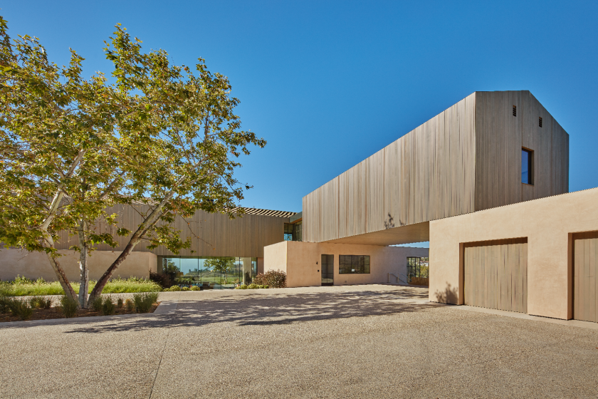 The modern mansion, built in 2021 by Noah Walker, holds 19,000-square-foot of spaces filled with glass, wood and stone.