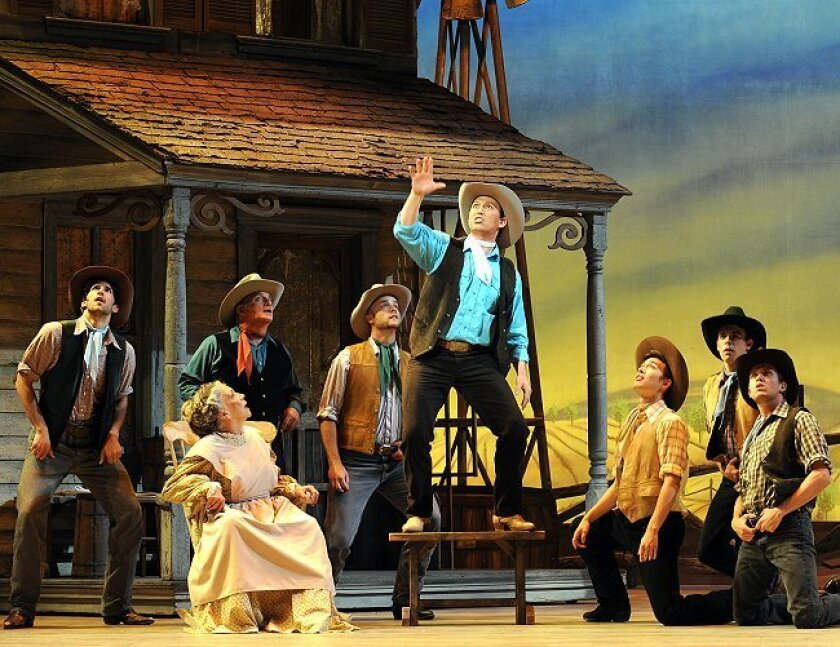 """Charles Martin (center, as Will Parker) and company in Moonlight Stage Productions' """"Oklahoma!"""""""