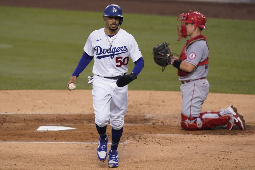 Los Angeles Dodgers' Mookie Betts scores against the Angels during the first inning Sept. 26, 2020.